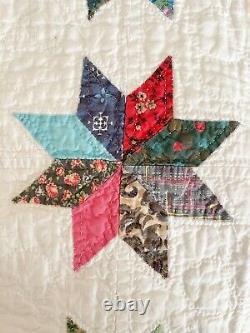 Hand-stitched antique/vintage feedsack quilt