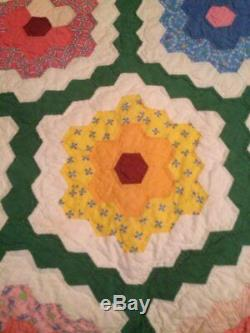 Vintage handmade Grandmother's Garden quilt